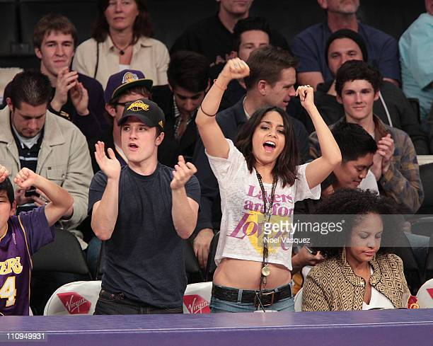 Vanessa Hudgens and Josh Hutcherson attend a game between the New Orleans Hornets and the Los Angeles Lakers at Staples Center on March 27 2011 in...