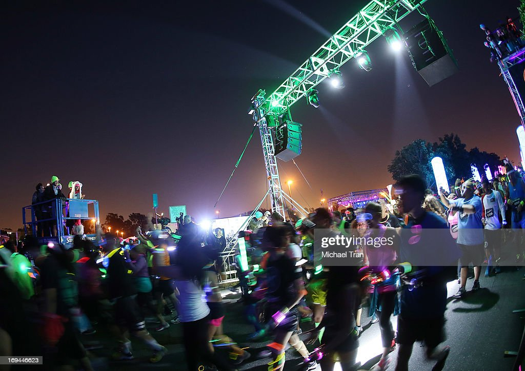 Vanessa Hudgens speaks atop a cherry picker/boom lift at the Electric Run LA held at The Home Depot Center on May 24, 2013 in Carson, California.