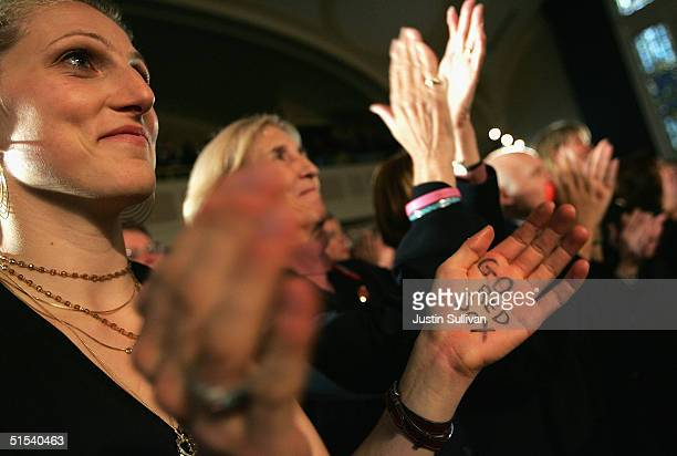 Vanessa Kerry daugter of democratic presidential candidate US Senator John Kerry as she applauds with the words 'Go Red Sox' on her hand as her...