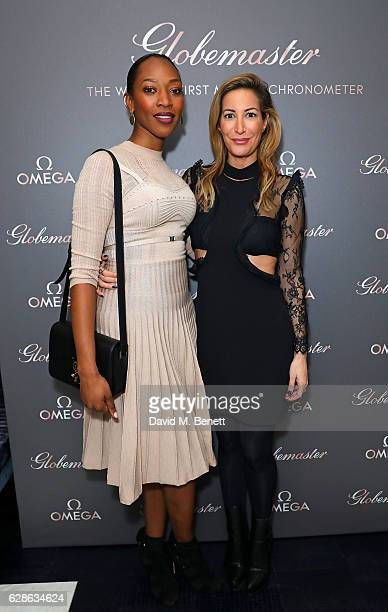 Vanessa Kingori and Laura Pradelska attend OMEGA Constellation Globemaster dinner at Marcus on December 8 2016 in London England