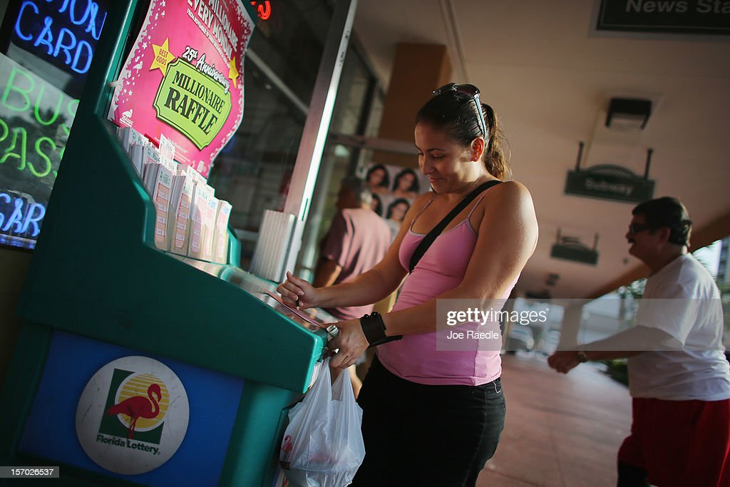 Vanessa Lopez fills out her Powerball numbers as she buys tickets at Circle News Stand on November 27, 2012 in Hollywood, Florida. The jackpot for Wednesday's Powerball drawing is currently at $500 million which is the richest Powerball pot ever. It is likely to rise even more as people continue to buy.