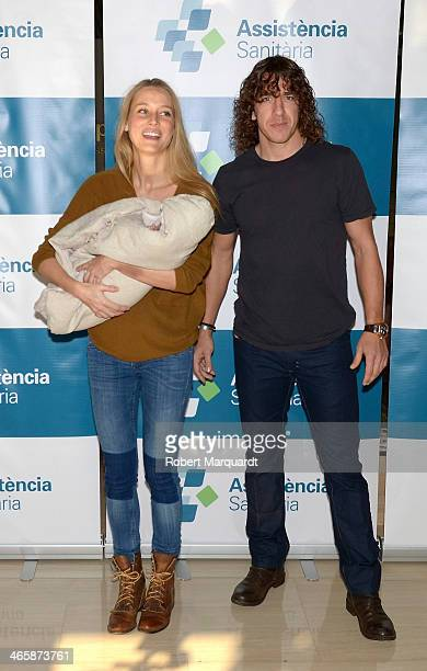 Vanessa Lorenzo and Barcelona football player Carlos Puyol present their new baby Manuela on January 30 2014 in Barcelona Spain