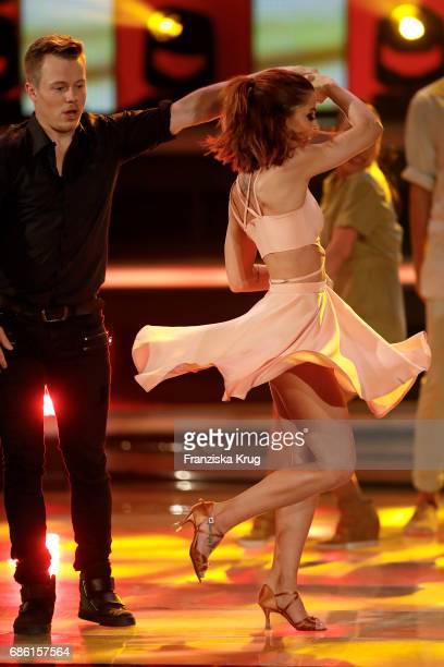 Vanessa Mai and Alexander Martens perform on stage at the tv show 'Willkommen bei Carmen Nebel' at Velodrom on May 20 2017 in Berlin Germany