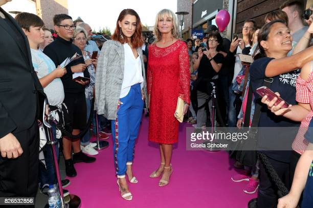 Vanessa Mai and Bo Derek wearing a red dress by Minx during the late night shopping at Designer Outlet Soltau on August 4 2017 in Soltau Germany