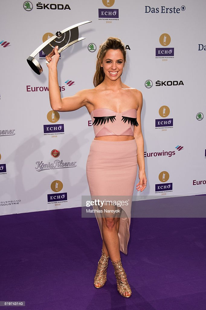 Vanessa Mai poses with her award at the winners board during the Echo ...