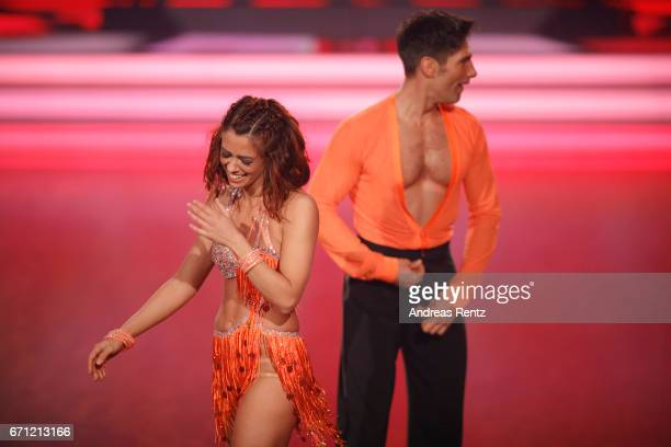 Vanessa Mai reacts to Christian Polanc having to fix his pants on stage during the 5th show of the tenth season of the television competition 'Let's...