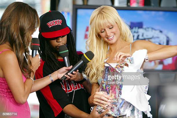 VJ Vanessa Minnillo rapper Lil Jon and socialite/actress Paris Hilton appear on stage during MTV's Total Request Live at the MTV Times Square Studios...