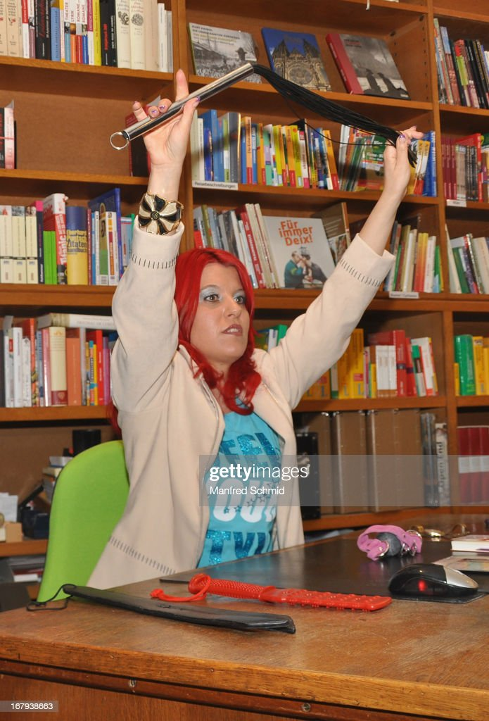 Vanessa Newton shows several instruments for the torture during the book presentation 'Schlimmer geht's immer' at Buchhandlung Quellenplatz on May 2, 2013 in Vienna, Austria.