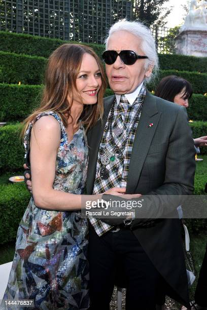 Vanessa Paradis and Karl Lagerfeld pose during the Chanel 2012/13 Cruise Collection at Chateau de Versailles on May 14 2012 in Versailles France