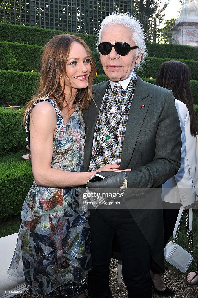 <a gi-track='captionPersonalityLinkClicked' href=/galleries/search?phrase=Vanessa+Paradis&family=editorial&specificpeople=206631 ng-click='$event.stopPropagation()'>Vanessa Paradis</a> and Karl Lagerfeld pose during the Chanel 2012/13 Cruise Collection at Chateau de Versailles on May 14, 2012 in Versailles, France.