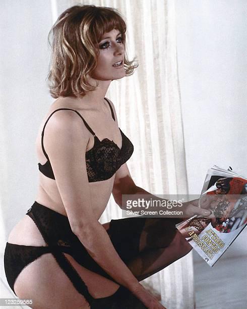 Vanessa Redgrave British actress wearing black underwear and holding an Italian magazine circa 1966