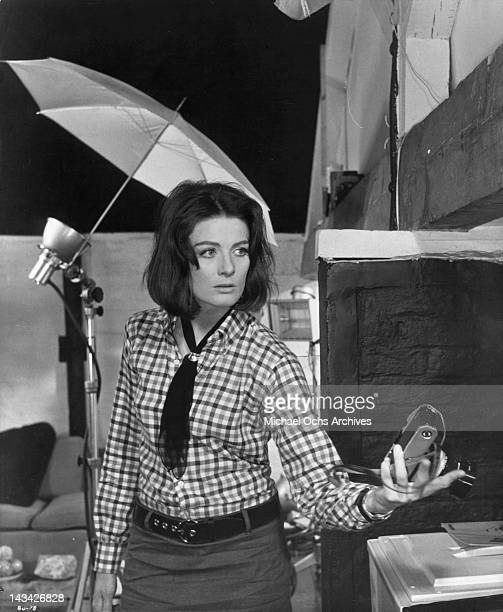 Vanessa Redgrave holding a camera in a scene from the film 'Blow Up' 1966