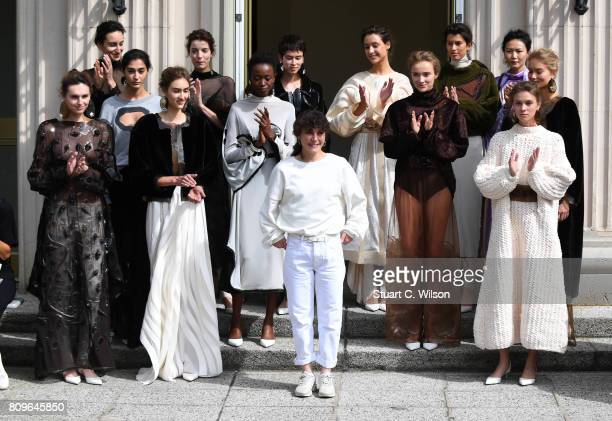 Vanessa Schindler poses with models following her show presented by MercedesBenz ELLE defile during 'Der Berliner Mode Salon' Spring/Summer 2018 at...