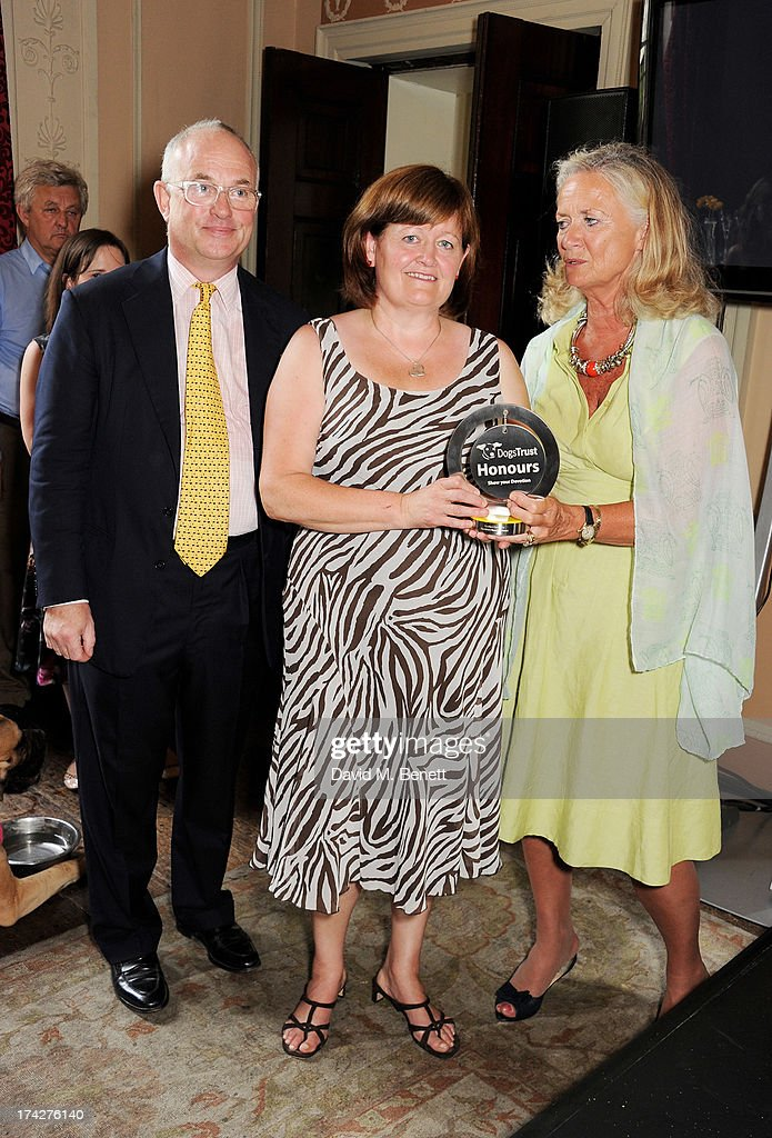 Vanessa Teanby (C), of the Pawfect Company winning Rambia Nursing Home, poses with Dogs Trust Chairman Philip Daubeny and Dogs Trust CEO Clarissa Baldwin at the Dogs Trust Honours held at Home House on July 23, 2013 in London, England.