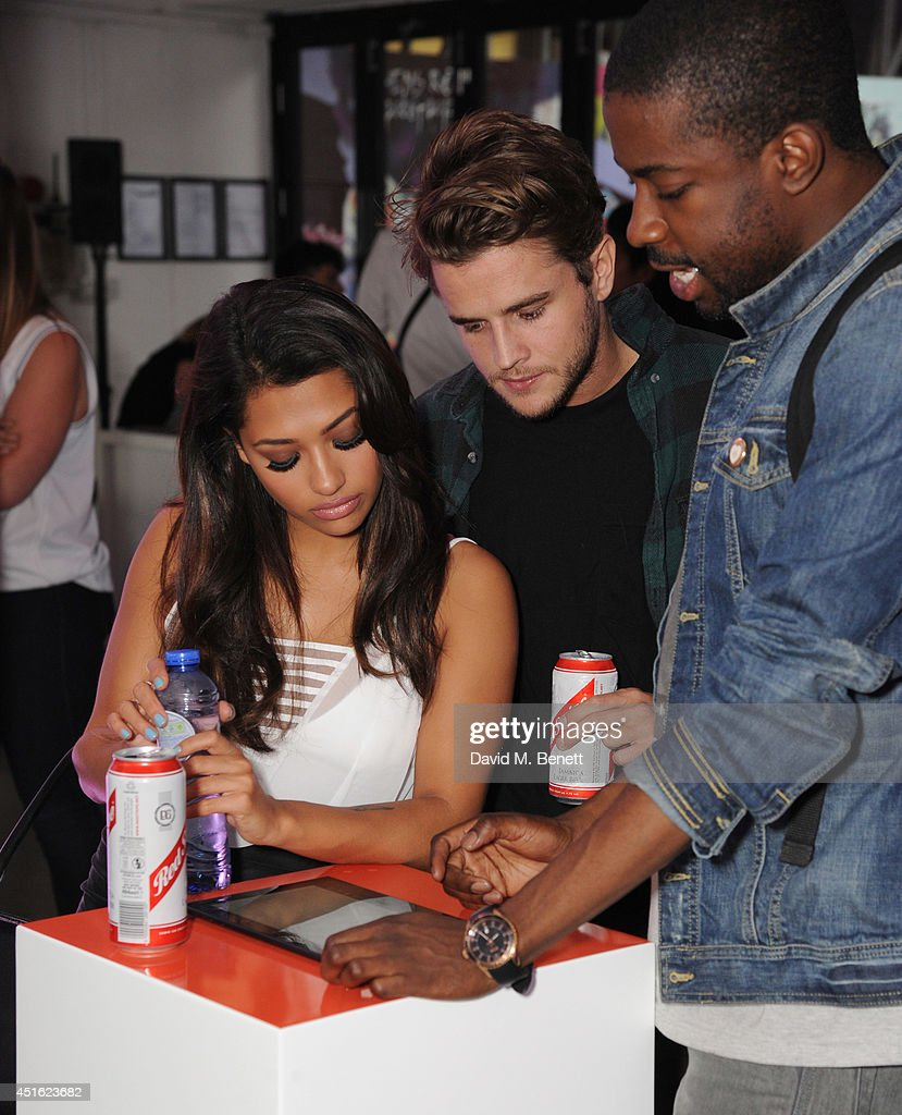 <a gi-track='captionPersonalityLinkClicked' href=/galleries/search?phrase=Vanessa+White&family=editorial&specificpeople=5523036 ng-click='$event.stopPropagation()'>Vanessa White</a> and Gary Salter (centre) attend the Nokia Lumia 630 #100aires Pop-up store, at The Old Truman Brewery on July 2, 2014 in London, England.