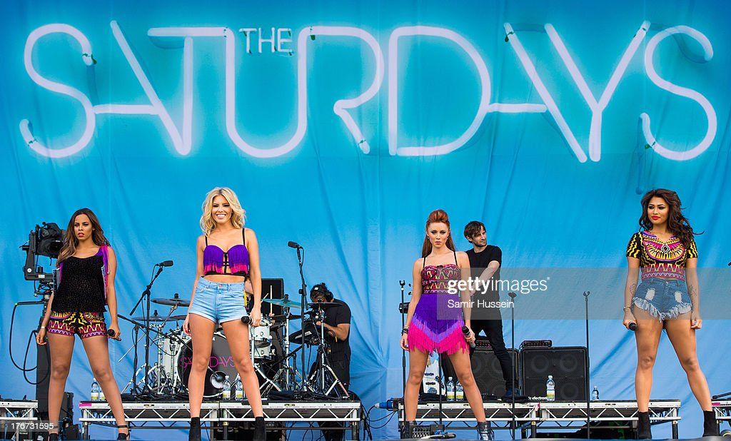 Vanessa White, Mollie King, Una Healy and Rochelle Humes of The Saturdays perform live on the Virgin Media Stage on day 2 of V Festival at Hylands Park on August 18, 2013 in Chelmsford, England.