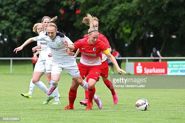Vanessa Ziegler of Freiburg fights for the ball with Soophia Kleinherne of Guetersloh during U17 Girl's German Championship semi final first leg at...