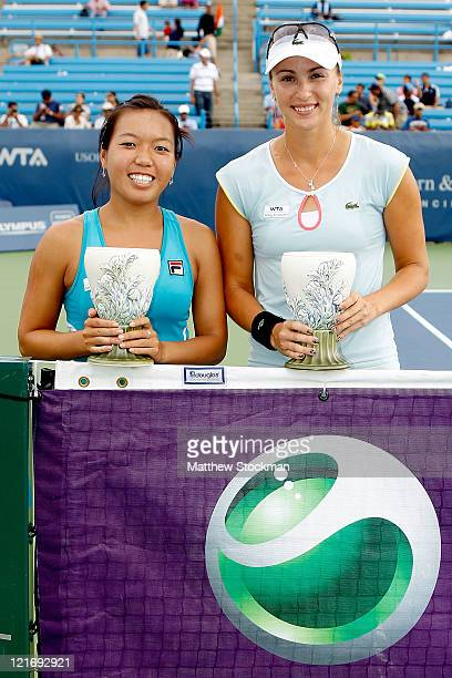 Vania King and Yaroslava Shvedova of Kazikstan pose for photographers after defeating Natalie Grandin and Vladimira Uhlirova during the final of the...