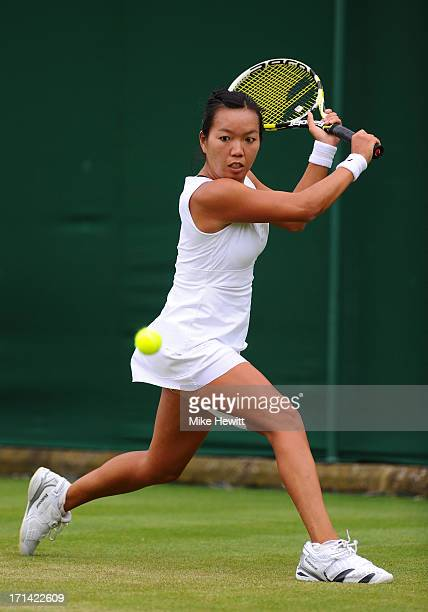 Vania King of the United States of America plays a backhand during her Ladies' Singles first round match against Alize Cornet of France on day one of...