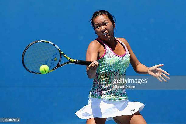 Vania King of the United States of America plays a forehand in her first round doubles match with Yaroslava Shvedova of Kazakhstan against Shuko...