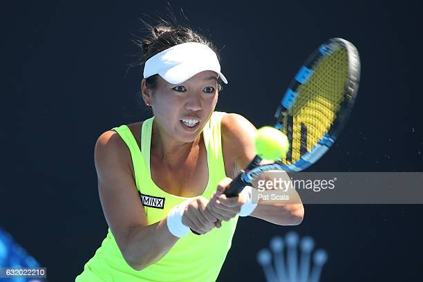 Vania King of the United States plays a backhand in her first round doubles match against Qiang Wang and Varatchaya Wongteanchai on day four of the...