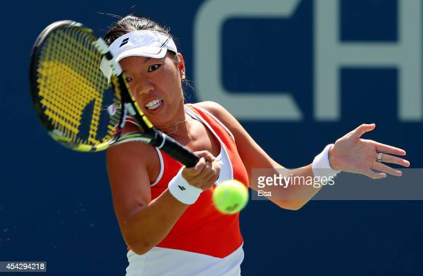 Vania King of the United States returns a shot against Serena Williams of the United States during their women's singles second round match on Day...