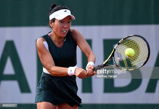Vania King of the United States returns a shot during her women's singles match against Taylor Townsend of the United States on day two of the French...