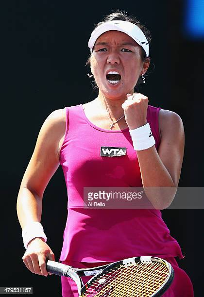 Vania King of the USA celebrates match point against Estrella Cabeza of Spain during their match on day 3 of the Sony Open at Crandon Park Tennis...