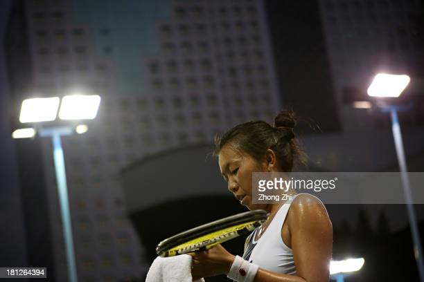 Vania King of the USA towels down in her singles match against Monica Puig of Puerto Rico during day four of the WTA Guangzhou Open on September 19...