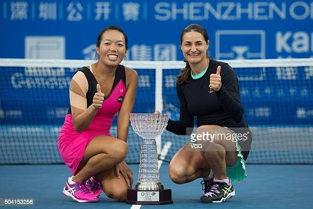 Vania King of USA and Monica Niculescu of Romania poses with the trophy after Women's doubles final match against Xu Yifan of China and Zheng Saisai...