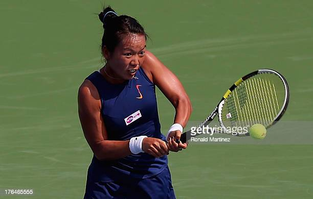 Vania King returns a shot to Victoria Azarenka of Belarus during the Western Southern Open on August 13 2013 at Lindner Family Tennis Center in...