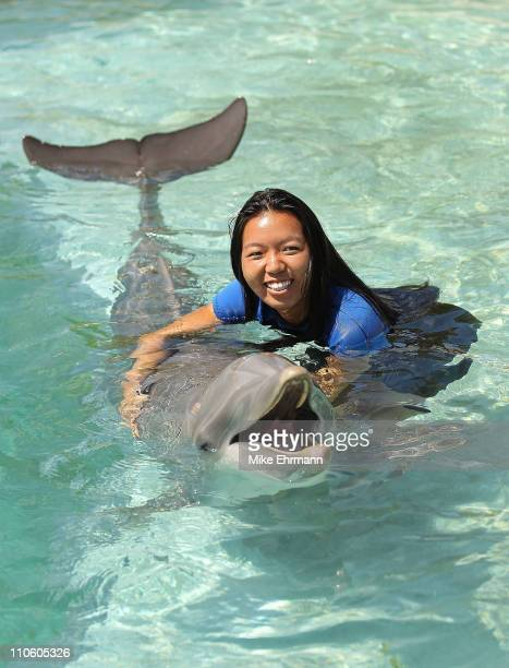 Vania King swims with the dolphins at the Miami Seaquarium during the Sony Ericsson Open at Crandon Park Tennis Center on March 22 2011 in Key...