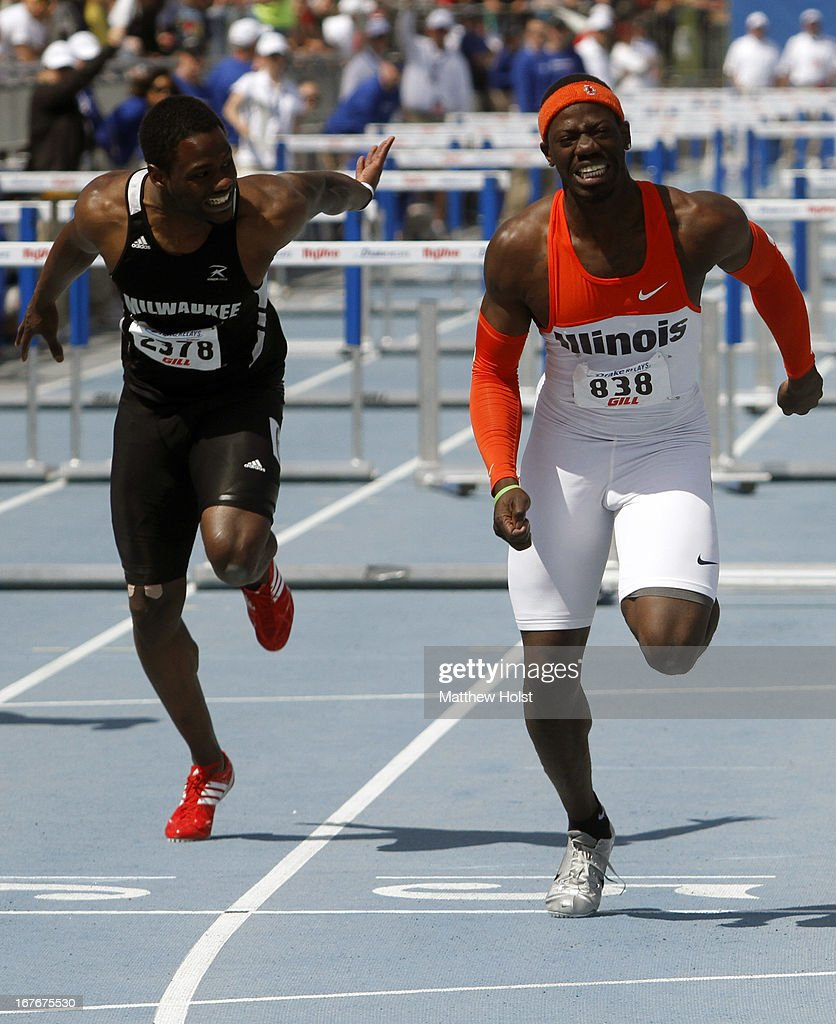 Vanier Joseph, of the Illinois Illini edges out Durell Busby, of the Wisconsin-Milwaukee Panthers in the Men's 110-meter Hurdles at the Drake Relays, on April 27, 2013 at Drake Stadium, in Des Moines, Iowa.