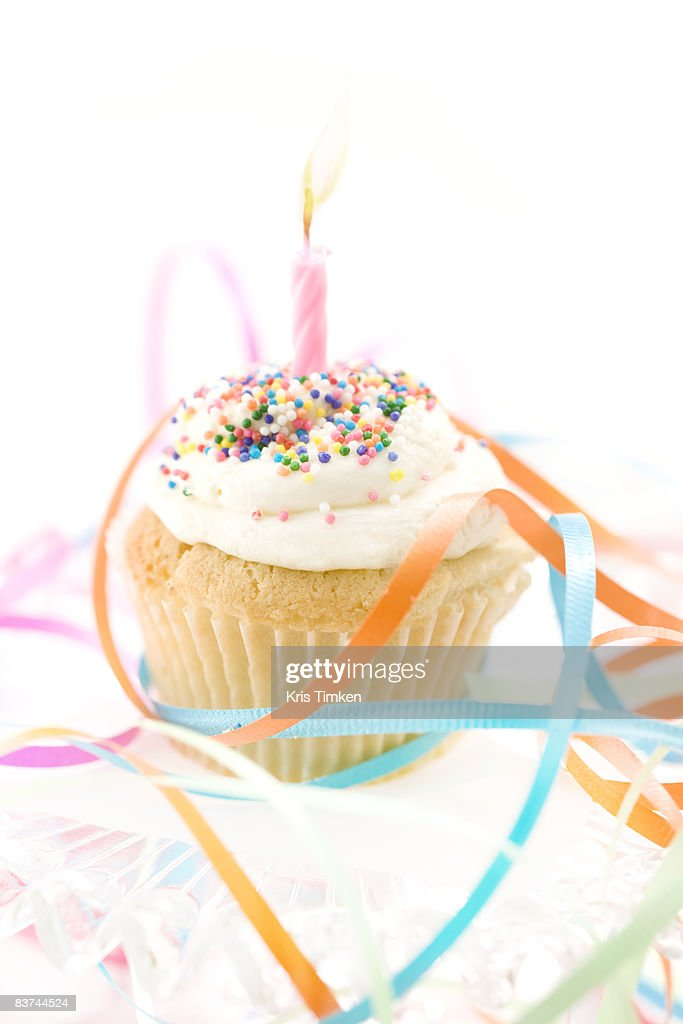 vanilla birthday cupcake and ribbon : Stock Photo