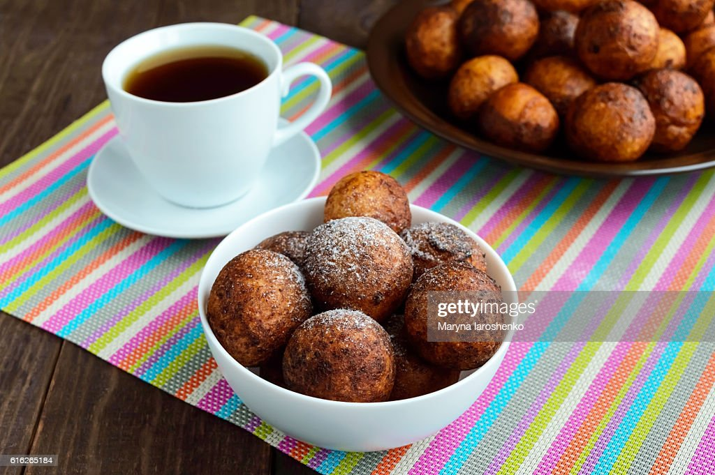 Vanilla cheese balls, deep fried and a cup of tea : Stock Photo