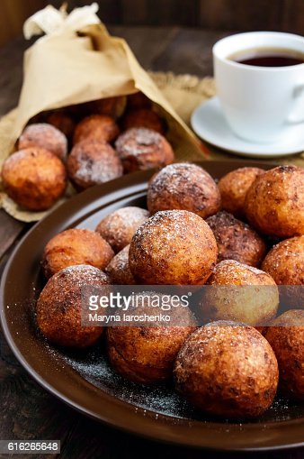 Vanilla cheese balls, deep fried and a cup of tea. : Stock Photo