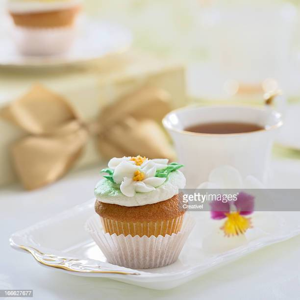 Vanilla cupcake with delicate buttercream icing flowers