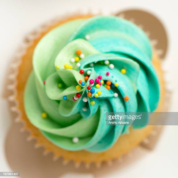 Vanilla cupcake with frosting and sprinkles