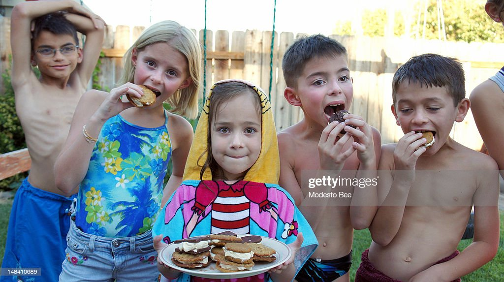 Vanilla ice cream makes a cool filling for molasses cookies. Here, Katie Wik, front row from left, Sophia Gallegos, Luke Wik and Ryan Stubbins enjoy the treat on a hot July day in Salida, California.