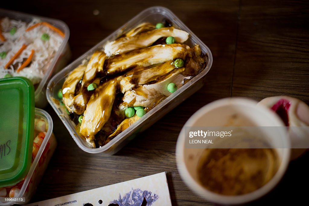 Vanilla-flavoured cake in the shape of a half-eaten Chinese takeaway meal is displayed at a film set pop-up experience in east London on January 17, 2013. The event was held to promote the release of a new horror film 'The Helpers'.