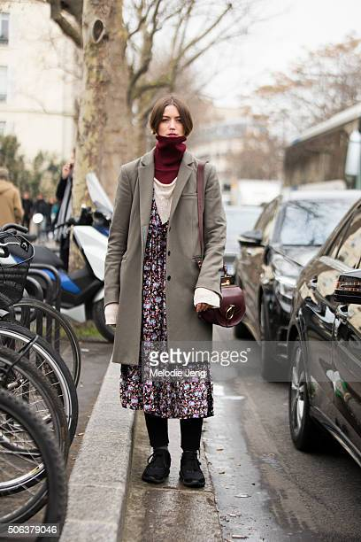 Vanille Verloes fashion designer wears a Margiela coat Zadig Voltaire turtleneck Chloe bag and her own floral dress on January 22 2016 in Paris France