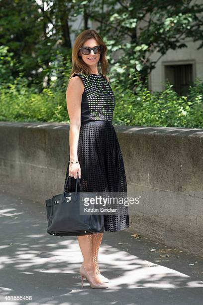 Vanina Sebaoum wearing a Carven dress Hermes bag Thierry Lasry sunglasses and Luis Vuitton shoes on day 1 of Paris Collections Men on June 25 2014 in...