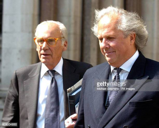 Vanity Fair editor Graydon Carter leaves the High Court in central London with writer Lewis Lapham