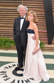 Vanity Fair EditorinChief Graydon Carter and Anna Scott Carter attends the 2014 Vanity Fair Oscar Party hosted by Graydon Carter on March 2 2014 in...