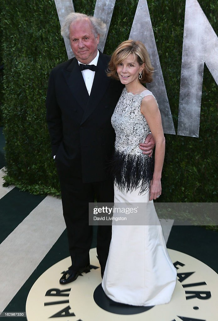 Vanity Fair Editor-in-Chief Graydon Carter (L) and wife Anna Scott attend the 2013 Vanity Fair Oscar Party at the Sunset Tower Hotel on February 24, 2013 in West Hollywood, California.
