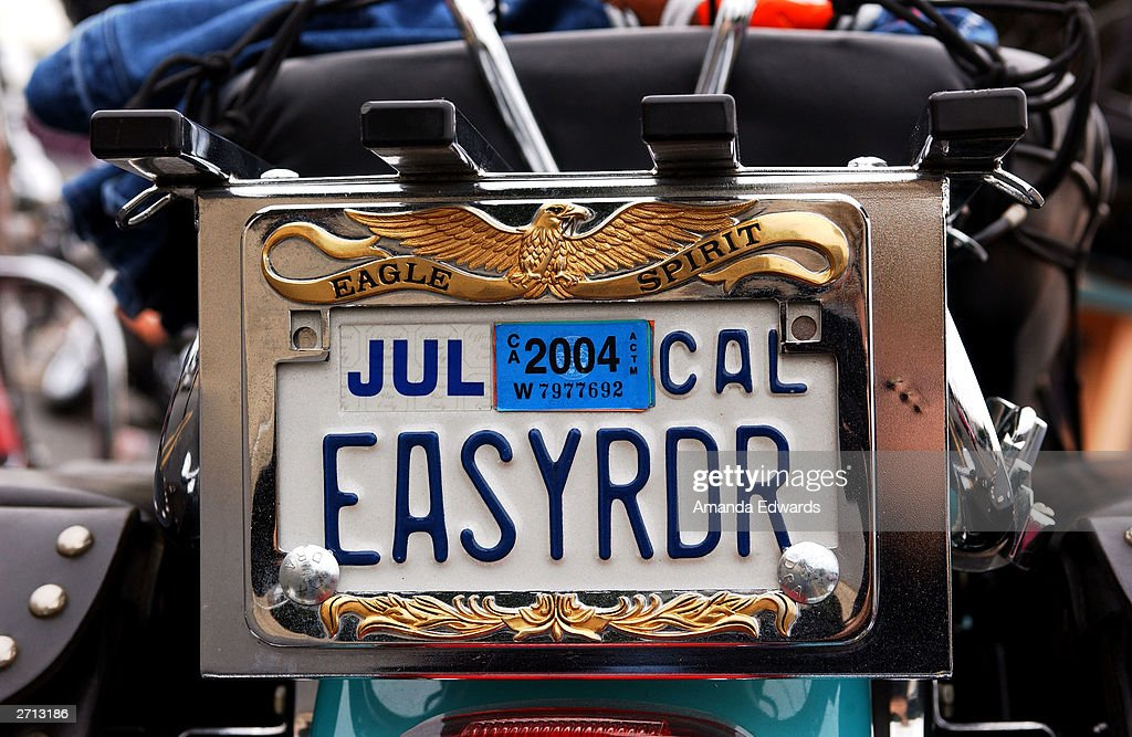 A vanity license plate sits on a HarleyDavidson motorcycle at the Love Ride 20 at HarleyDavidson/Buell of Glendale November 9 2003 in Glendale...