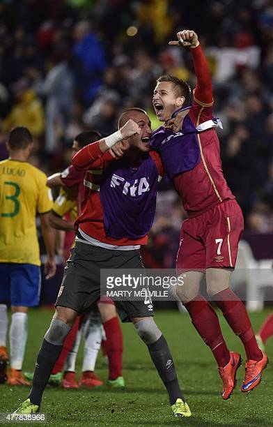 Vanja Milinkovic and Ivan Saponjic of Serbia celebrate their win in the FIFA Under20 World Cup football final match between Brazil and Serbia at...
