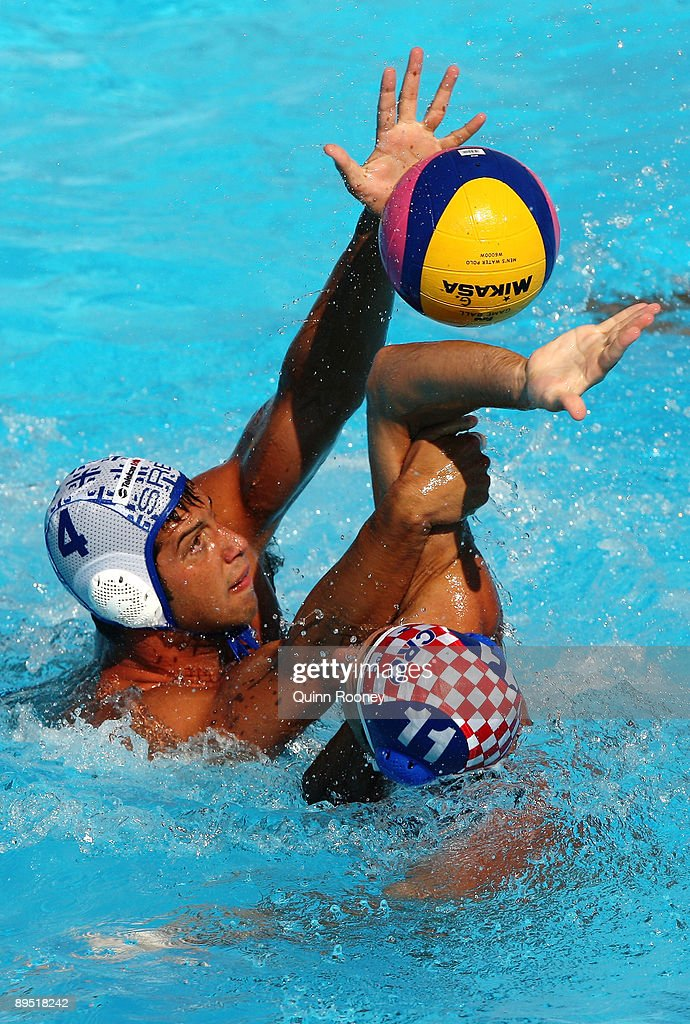 Vanja Udovicic of Serbia and Igor Hinic of Croatia battle for the ball during the 13th FINA World Championships at the Stadio della Pallanuoto on...