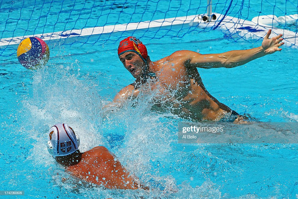 Vanja Udovicic of Serbia attempts to score against the defense of James Clark of Australia during the Men's Water Polo first preliminary round match...