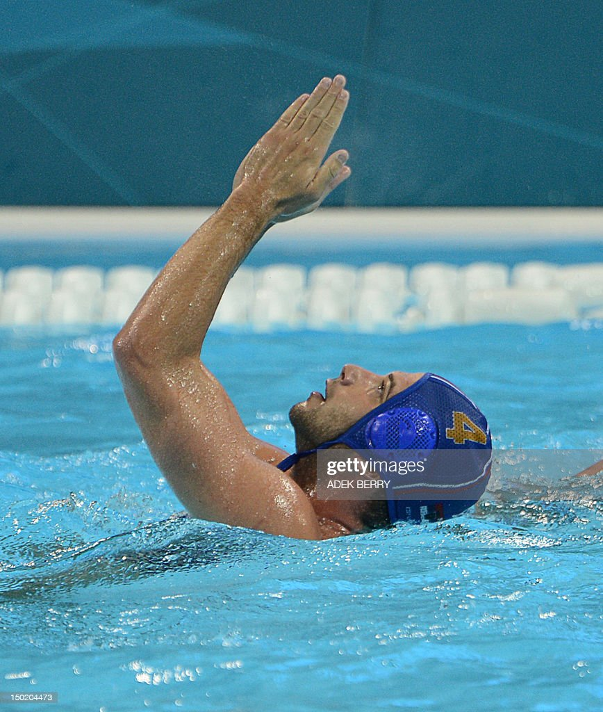 Vanja Udovicic of Serbia celebrates a goal during the men's water polo bronze medal match Montenegro vs Serbia at the London 2012 Olympic Games in...
